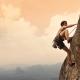 athletic man climbing a mountain